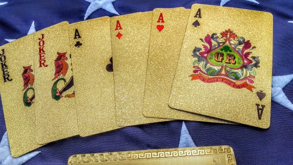 "24K GOLD President Trump Playing Cards Trump - Make Your Poker Game Great Again! Before he became the 45th President of the United States, Donald Trump established a name for himself as a real estate developer, television personality and the owner of several high-class resorts and casinos around the world. Now you can feel like a real high roller at a table inside Mr. Trump's exclusive Mar-a-Lago Club for a friendly game of cards. And what better way to make your game of poker great again than with this deck of 24-karat gold foil cards that feature the image of President Trump himself! Perfect for any patriotic Trump supporter, this deck of 24-karat Gold Foil Donald Trump Playing Cards makes an ideal gift. Made of durable construction, each deck comes in its own colorful acrylic box. And at this low price, you can deal in everyone on your list! Each card in the deck is a standard 2½"" x 3½"" size and was sealed in 99.99% 24K GOLD finished to a stunning mirror-like shine!  Uncirculated condition. EACH DECK comes with 52 playing cards and two jokers ALONG WITH A 24K GOLD CERTIFICATE OF AUTHENTICITY CARD - perfect for any card game! What really seals the deal is the addition of a full-color holographic print on the back of each card that shows President Trump in the foreground with the Capitol Building and a waving American Flag in the background. To top it off, ""USA"" is boldly printed in the upper right corner. STURDY PLAYING CARDS! QTY: 1 SET OF 54 24K Gold Cards QTY: 1 24K GOLD Certificate of Authenticity Card 100% High Quality and Brand New Playing Cards Material: Gold Foil Playing Cards Size: approx. 87 * 57 mm or 3.4 * 2.3 inch Weight: approx. 130 g or 4.6 oz The gold cards have a great durable feel - they are made of high quality plastic. They will not bend or chip corners as easily as the normal deck of playing cards. Highly flexible, durable, scratch less, non fade, waterproof and shining like gold. This is a great talking point and certainly a very unique gift for friends and relatives, especially card collectors who are Trump fans!."