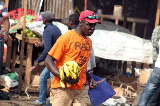 Police launch manhunt for NASA supporter pictured holding a bloody knife