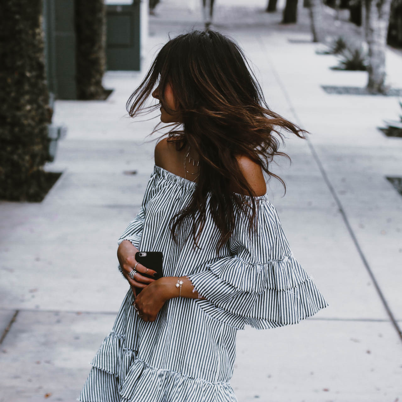 photo of style blogger jami alix wearing zara striped mini ruffle dress for street style ootd blog post