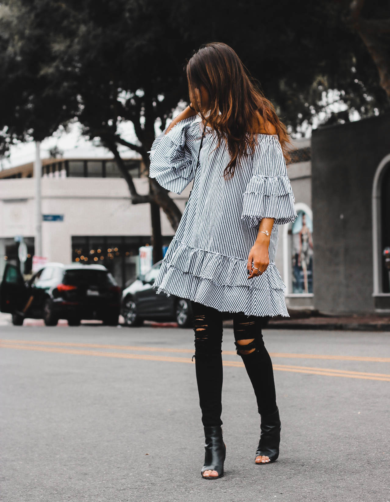 street style photo of style blogger jami alix wearing striped ruffle dress by Zara, summer ootd