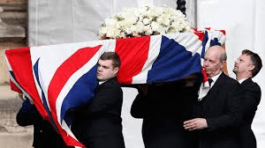 Thatcher's coffin being led to the ground by the BNP, who won the competitive bid to run her funeral.