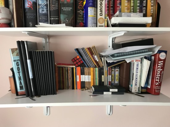 Bookshelf of notebooks