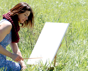 Jamie Wilke with canvas in field - Colorado Artist