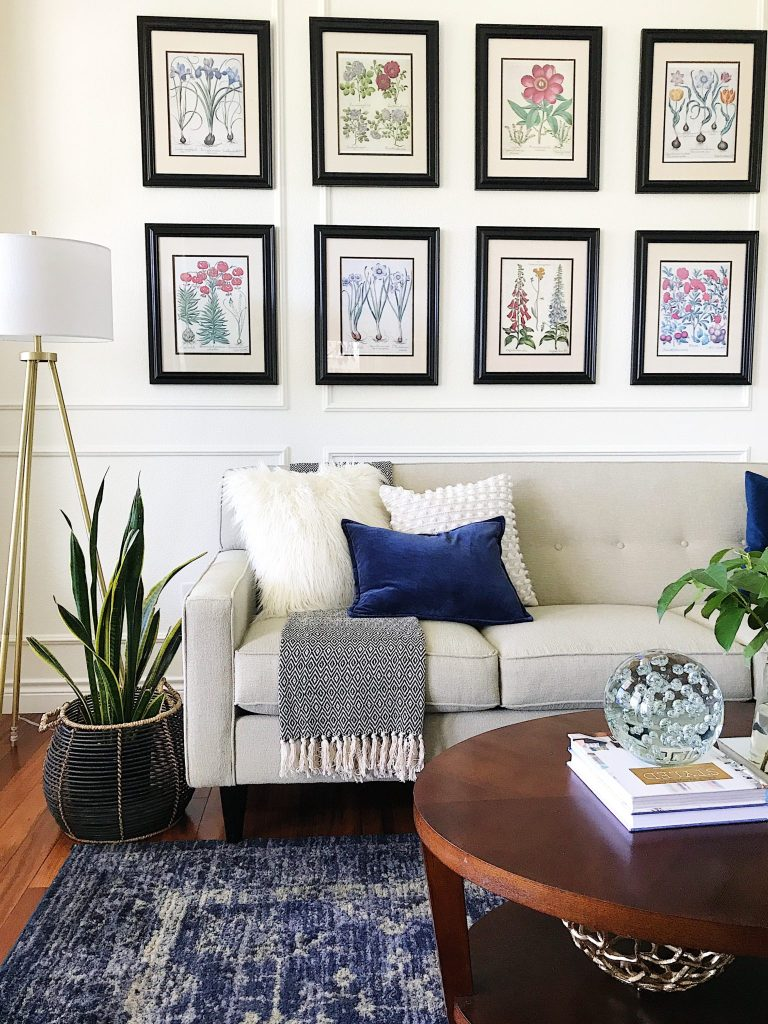 Modern living room with panel moulding, botanical gallery wall, vintage blue rug-refresh your home decor