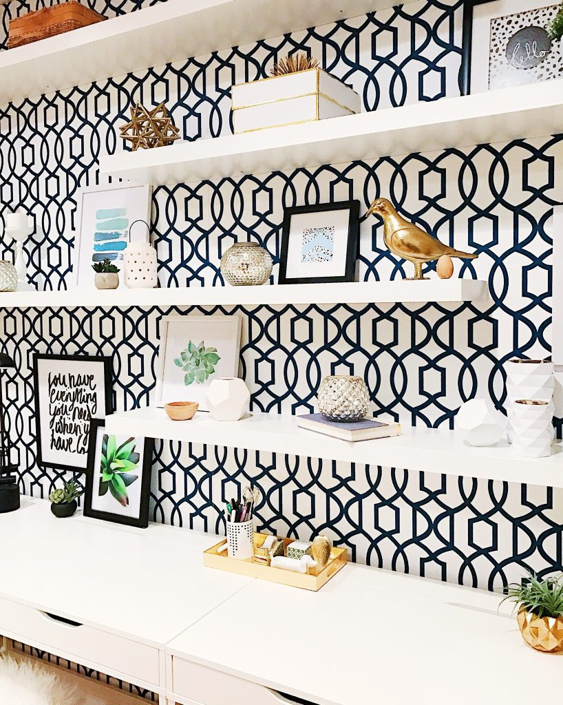 5 Tips to Declutter Your Home and Simplify Your Life-white office work space with geometric wallpaper and open shelving