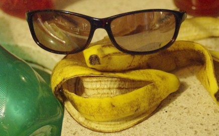 A banana peel made to resemble a face, with sunglasses added for eyes.