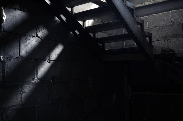 Image: dim light from top of basement stairs