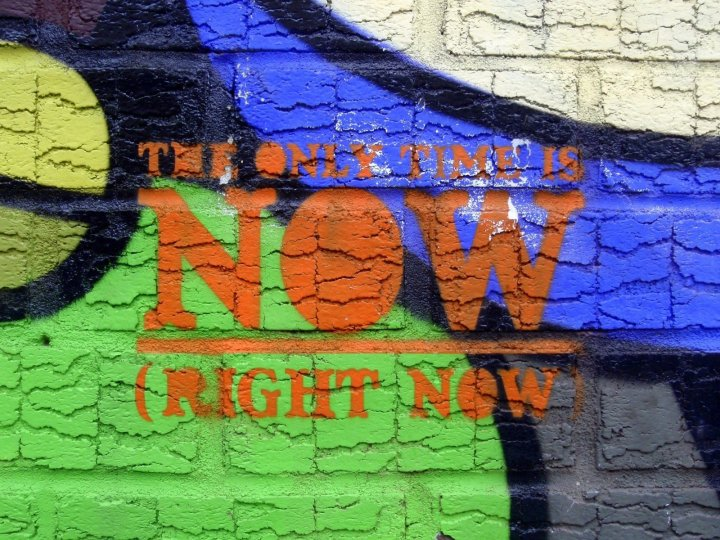 "Image: wall mural with the words ""the only time is now (right now)"""