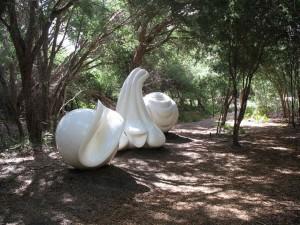 white curvy sculptures in bush