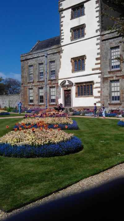 Flowerbeds in front of manor house