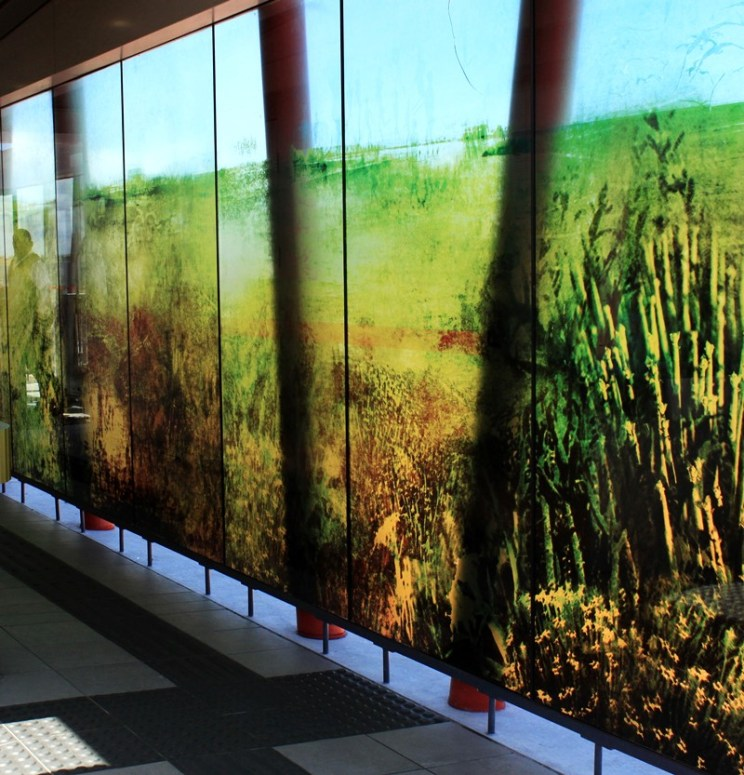 Landscape montage applied as vinyl print to the Sandown bus station in Bloubergstrand