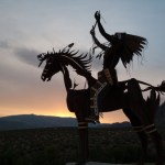 native sculpture at sunset in okanagan valley, british columbia, canada