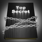 A book titled Top Secret wrapped in steel chains.