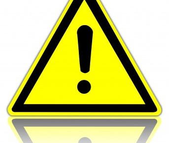 a yellow triangle sign with an explanation point inside it