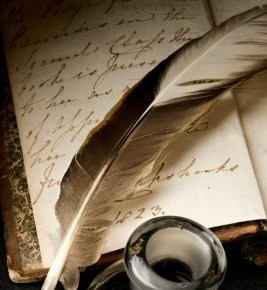 feather and ink pot on writing paper
