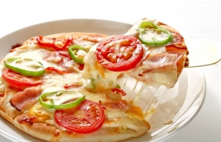 a veggie pizza with fresh tomatoes