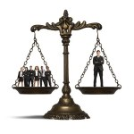 legal scales with a crowd on one side and one man on the other side