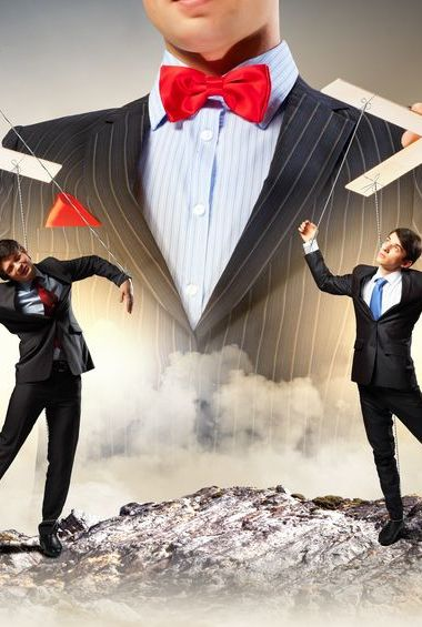 Image of young businessman puppeteer
