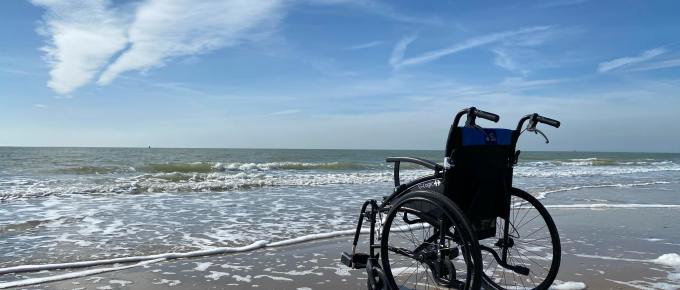 an empty wheelchair on the beach