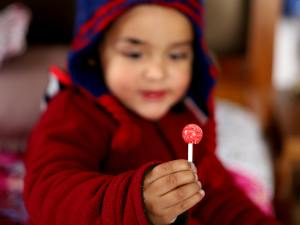 a little boy with a lolly-pop
