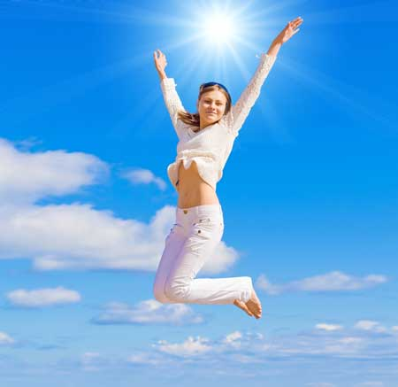 energised-woman-jumping-in-the-air
