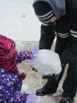 Kevin and Emma making snowballs!!