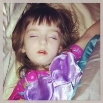 Lily sleeping while wearing her Princess Ariel costume
