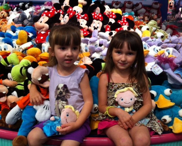 The Girls Hanging with the Stuffed Animals at the local Disney Store after feeling like I had been the worst mom earlier in the day.