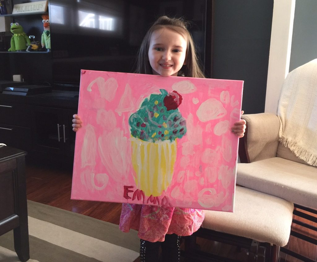 Emma Proudly Holding Her Painting