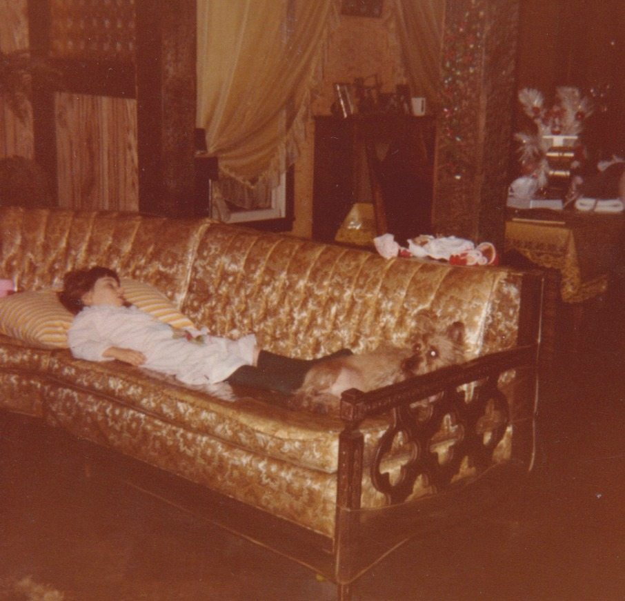 Me as a kid fast asleep on the couch