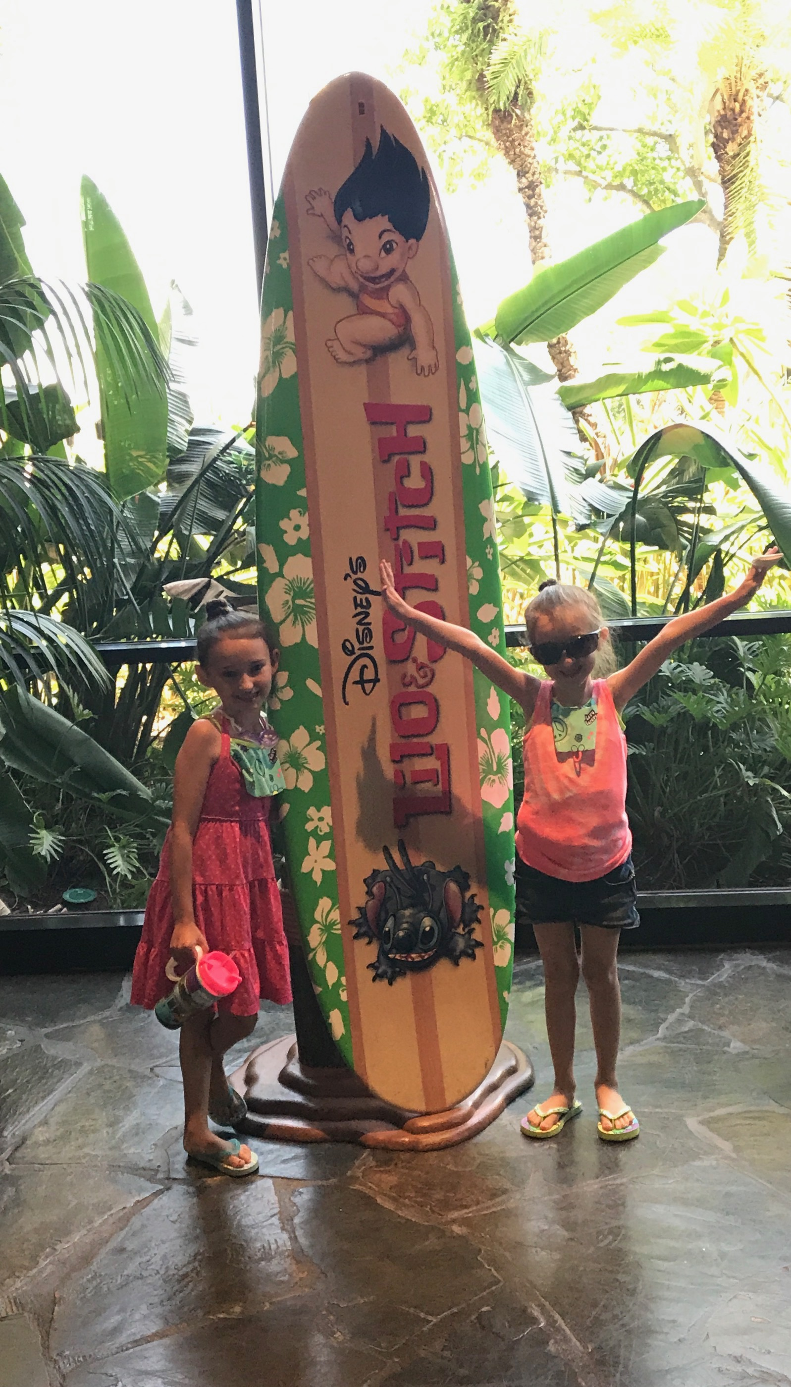 At Disney Polynesian Resort in front of Lily and Stitch Surfboard