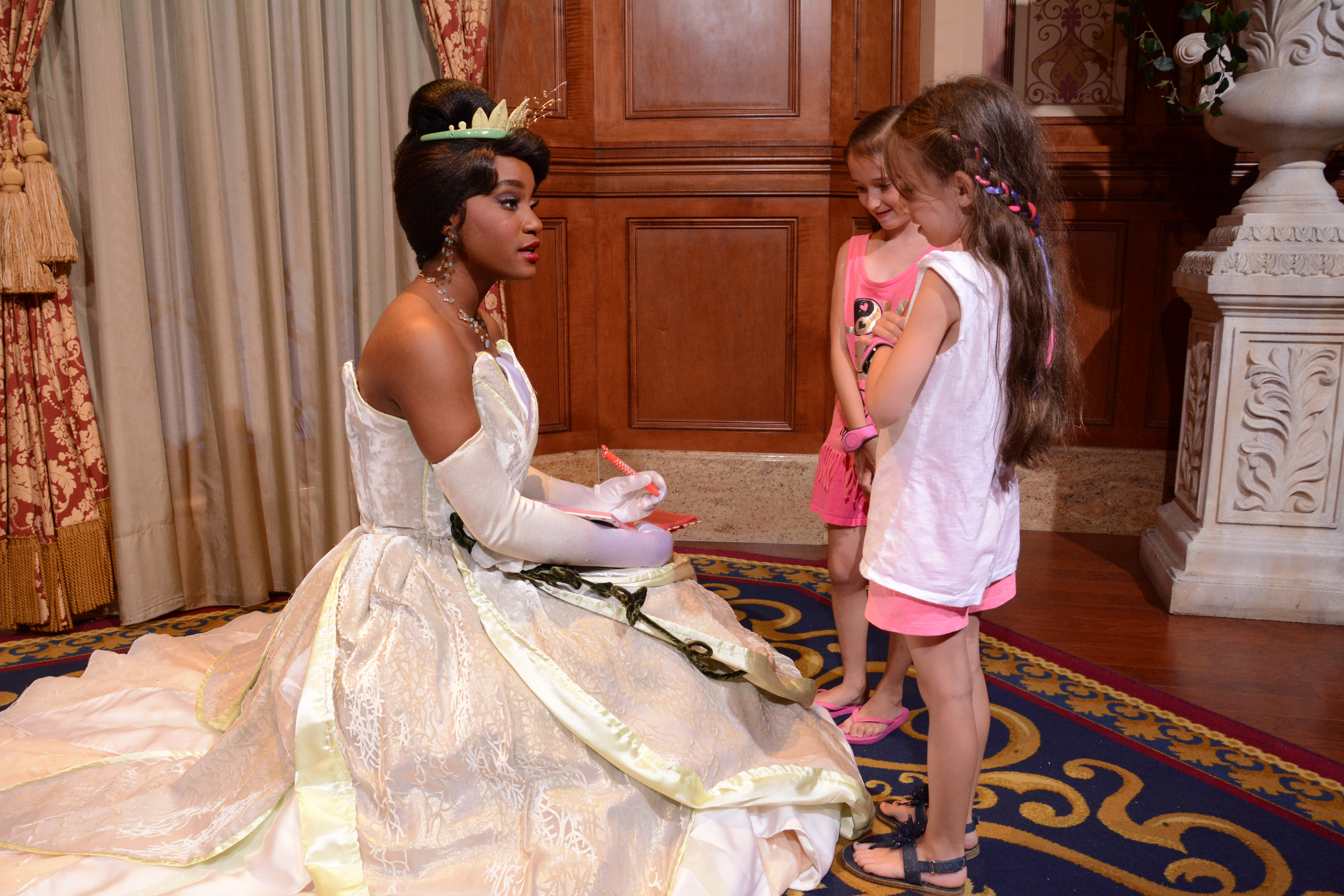 Tiana at Disney World with girls