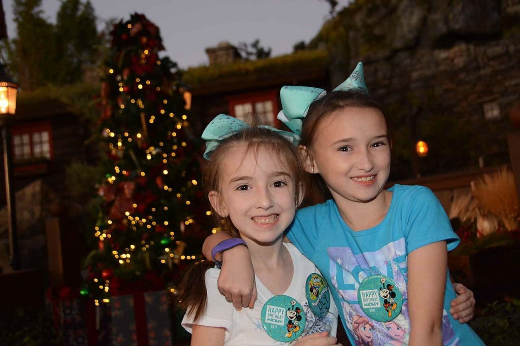 Girls in front of Tree at Epcot in Norway