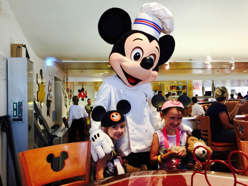 Girls with Mickey Mouse at Disney World Chef Mickeys