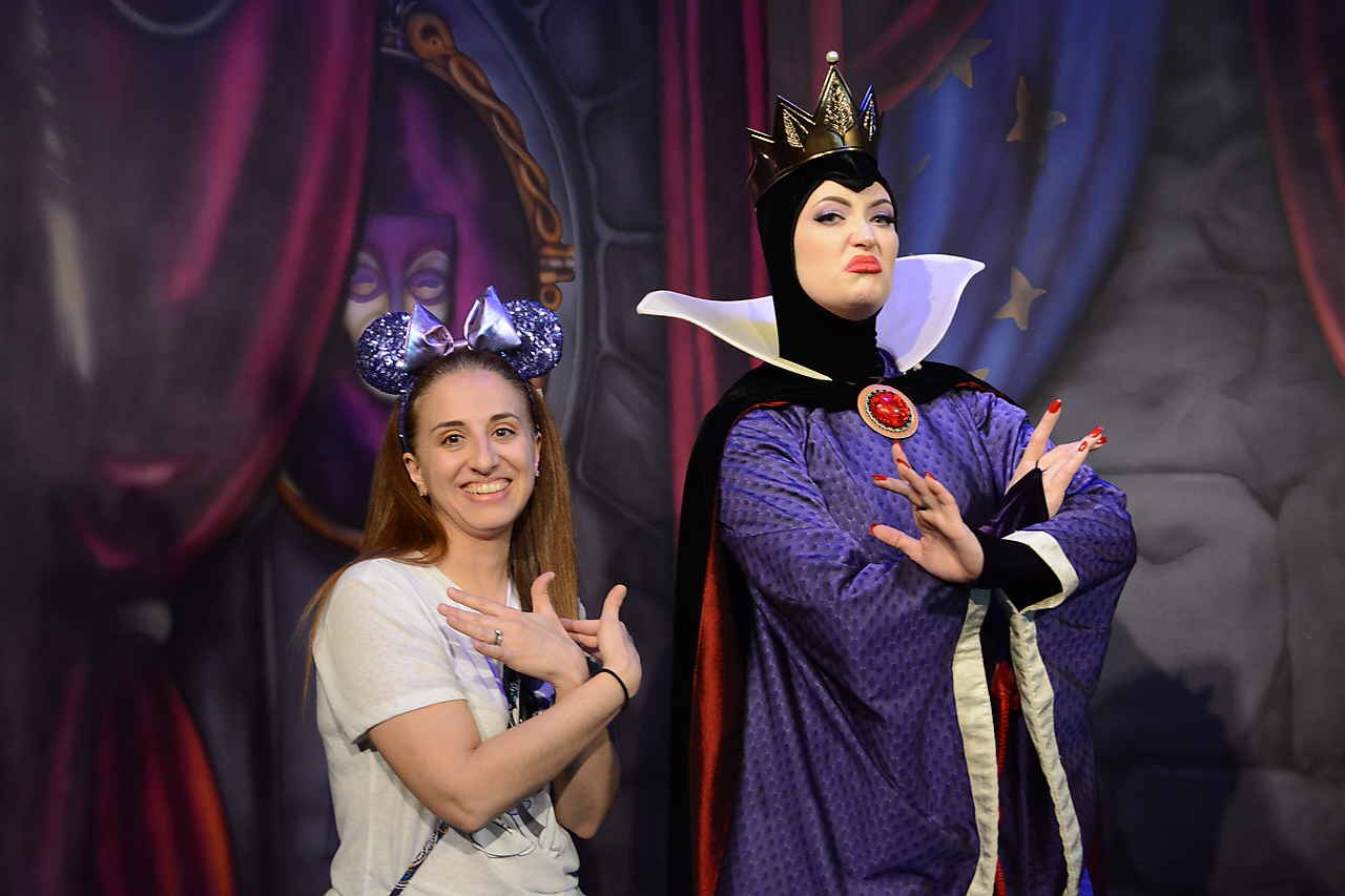 Posing with the Evil Queen at Artist Point's Storybook Dining Experience at Wilderness Lodge at Walt Disney World