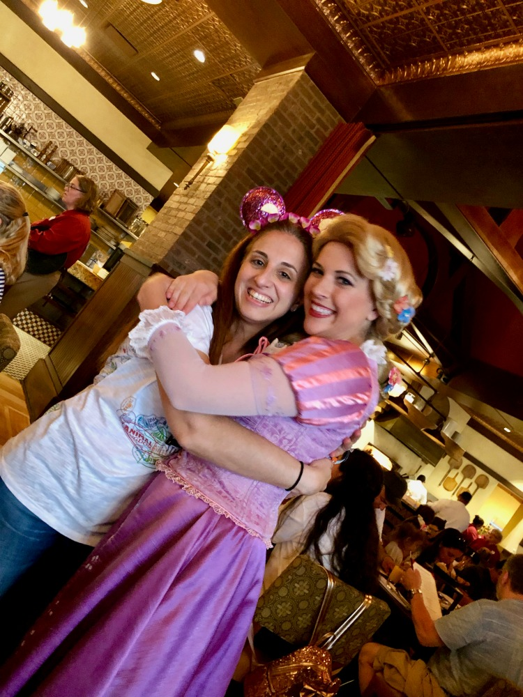 Hugging Rapunzel at The Bon Voyage Breakfast at La Trattoria at the Disneys Boardwalk