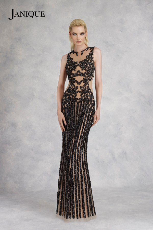 Embroidered sleeveless sequin dress by Janique in nude black. Long beaded applique gown in black nude with no sleeves.
