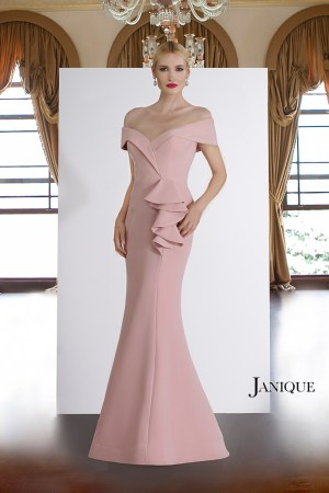 Off shoulder evening wear gown with ruffle peplum by Janique. Stretch crepe couture sleeve designer long dress in blush.