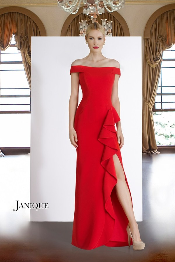 Off the shoulder with sleeve dress with ruffle slit. Long dress in red by Janique with ruffle skirt. Red gown with slit.