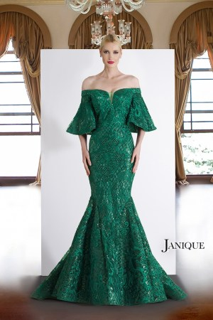 Off the shoulder lace long dress with bell short sleeves in green. Emerald lace embroidered gown with train by Janique.