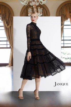 Designer lace short dress in black. Short dress with lace by Janique in black. Black long sleeve lace cocktail dress.