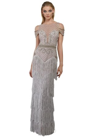 Glamorous pageant dress. Silver embroidered long dress with fringe. Encrusted bodice and arm strap long dress with fringe by Janique in silver.