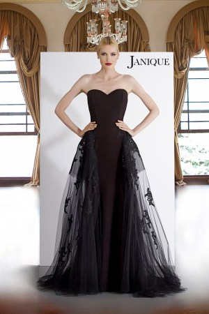 Strapless gown with transparent overlay skirt with floral lace applique. Designer black dress with black lace on skirt.
