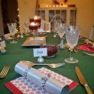 Crackers, candles and cranberries – table ready for Christmas Dinner