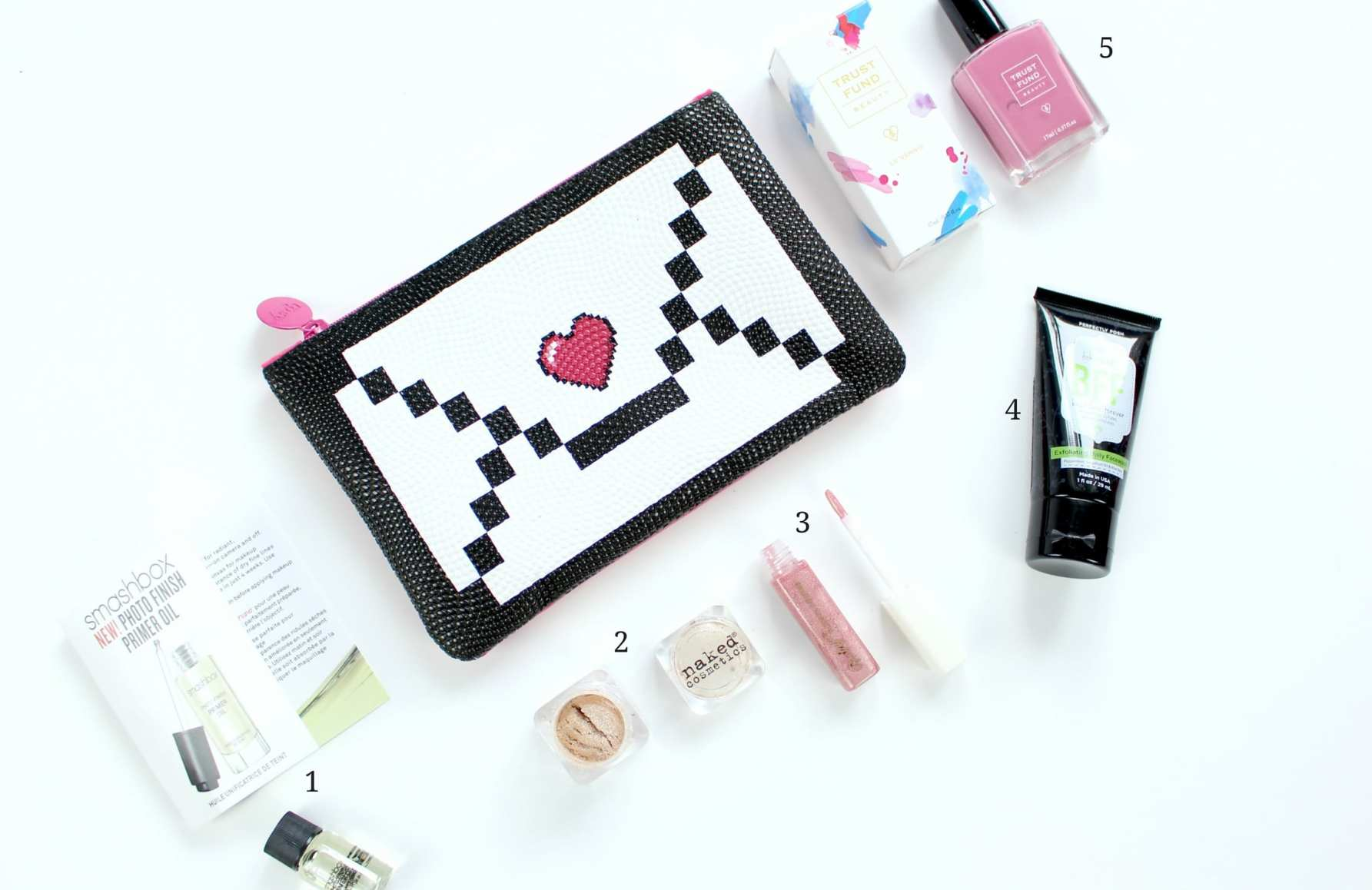 February's Ipsy Glam Bag Review of Trust Fund Beauty nail polish, Perfectly Posh BFF face wash, Naked Cosmetics mica pigment, Smashbox Cosmetics primer oil, and Vintage lipgloss.