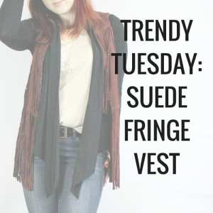 Layer a suede fringe vest for a cute 70s inspired layered outfit. Tank top, denim jeans, black shawl, and suede fringe vest.