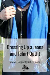How to dress up a jeans and tshirt outfit with jewelry, a scarf, booties, and a moto jacket.