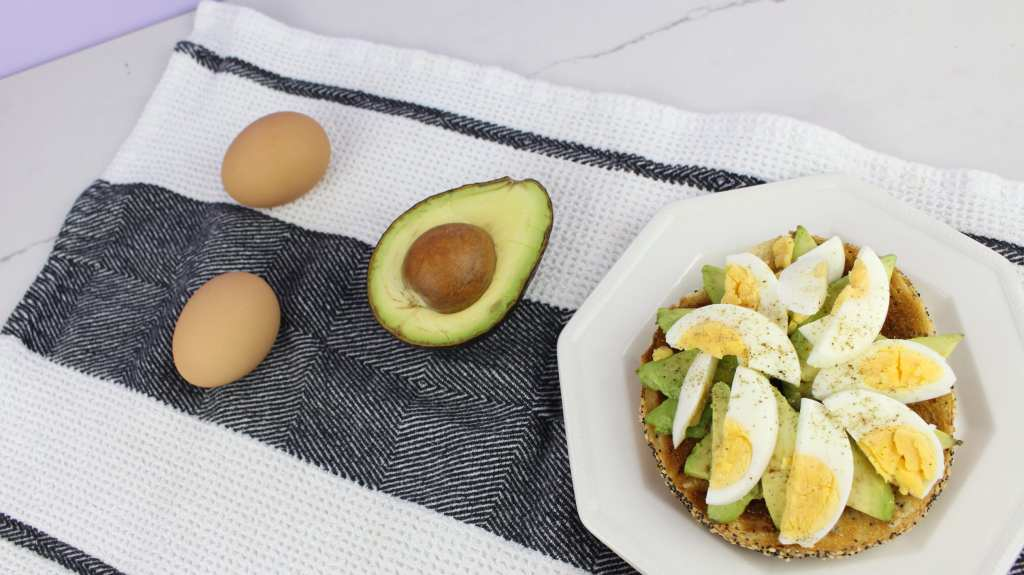 Avocado and Egg - 15 Ways to Top Your Breakfast Bagel - Happy Stylish Fit