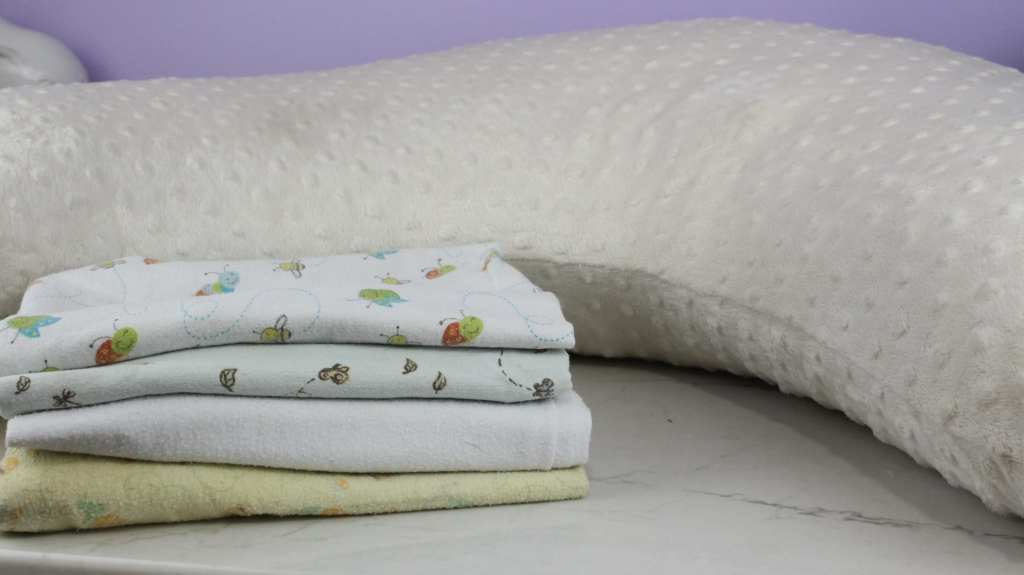 Breastfeeding pillow and receiving blankets are must haves for your nursing essentials.