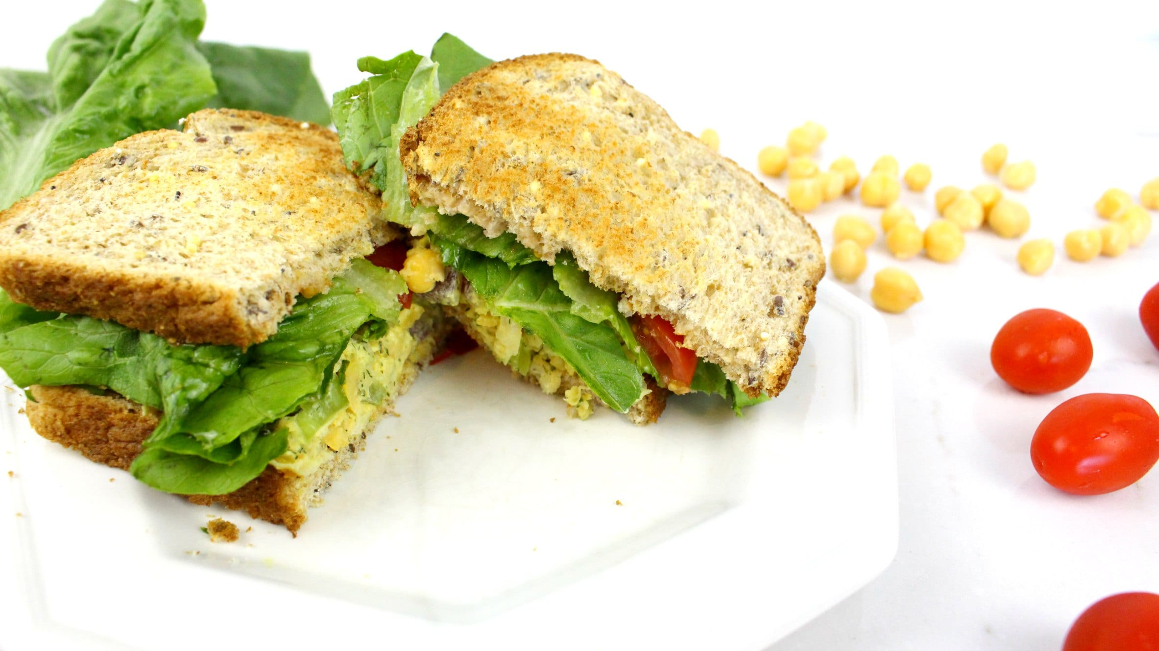 A chickpea tuna sandwich recipe that is sure to fulfill vegetarians cravings for tune. It's totally vegan and the perfect sandwich for a healthy lunch.